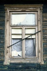 Wooden house, facade, detail, window, old, broken, house, building, log cabin, wood facade, wooden window frames, window panes, damaged, dilapidated, damaged, neglected, uninhabited, abandoned, product photography,