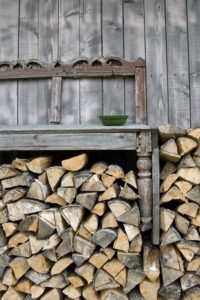 Woodpile, Bench, house wall, detail,