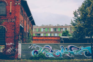 Germany, Saxony-Anhalt, Dessau, building, old, wall, graffiti, Federal Environmental Agency in the background