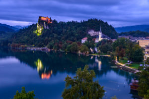 Slovenia, Gorenjska, Upper Carniola, Bled, Bled Lake, Bled Castle and St. Martin Parish Church, view from Hotel Park