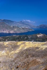 Italy, Sicily, Aeolian Islands, Vulcano, Gran Cratere, crater rim with fumaroles against Lipari and Vulcanello