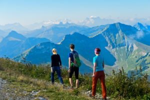 Three hikers in the Moleson hiking area, Moléson-sur-Gruyères, Canton of Friborg, Switzerland