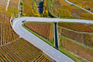 Hairpin bend of a country road in the vineyards near Leytron, Valais, Switzerland