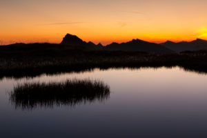 Glowing sky, morning mood at a mountain lake, alpenglow
