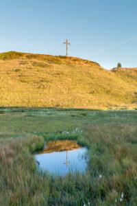 Summit, summit cross is reflected in lake, heaven