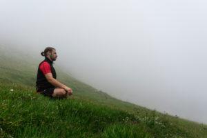 Man, mountains, meadow, meditate, fog