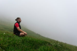 Man, mountains, meadow, meditate, fog