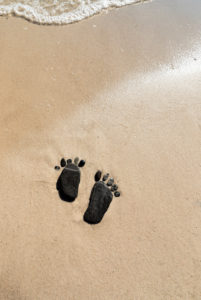Footprints made of flat stones on the beach,
