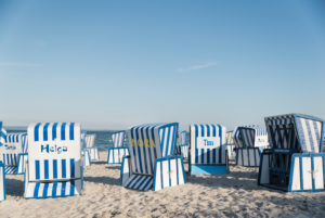 Blue-white striped beach chairs on the island of Rügen, Baltic Sea, with name,