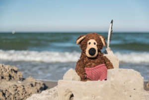 Teddy in beach castle, in the background the Baltic Sea,