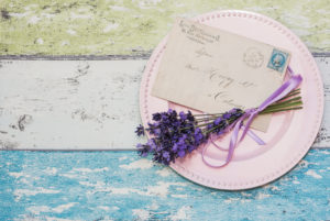 floral still life with lavender floral still life with lavender and old letter on pink plate