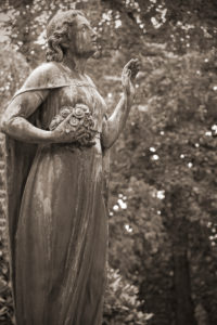 Female statue on cemetery