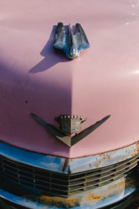Pink Cadillac classic car in front of restaurant in Virgina, USA, old, rusty