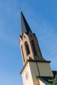 Rottendorf church tower near Wuerzburg in Lower Franconia / Catholic Church