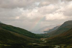 Landscape in Scotland's highlands rainbow over valley