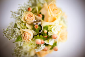 Detail, wedding, bridal bouquet with wedding rings