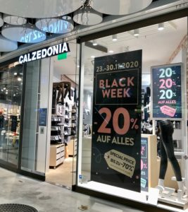 Black Friday poster on shop front in Stachus Passagen Munich