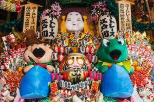 Japan, Honshu, Tokyo, Taito-ku, Otori Shrine, Decorative Good Luck Rakes called Kumade for Sale at the Tori-no-Ichi Festival held Annually in November