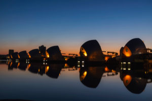 England, London, Greenwich, The Thames Barrier and River Thames at Night