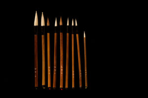 Chinese brush set on a black background