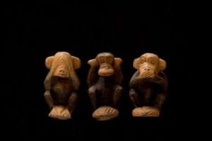 Three Wise Monkeys on a black background, See no evil, hear no evil, speak no evil, Nizaru, Kikazaru, Iwazaru