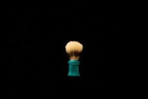 Shaving Brush on the black background, vintage