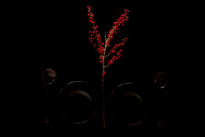 Ilex with japanese wooden tableware on a black background