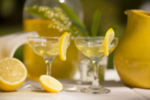 Lemon slices on the side of the cocktail glasses, Homemade Limoncello