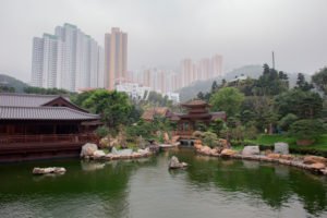 Pond at Nan Lian Garden, Diamond Hill, Kowloon, Hong Kong, skyscrapers in the background