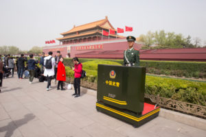 Guard stands on area of Tiananmen Gate, Forbidden City, Beijing, China
