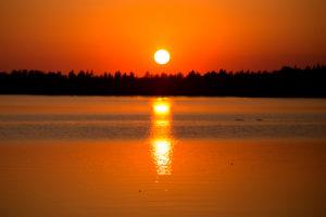 Beautiful sunset reflecting on the lake surface, Finland