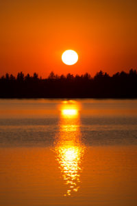 Sunset is reflecting on the lake surface, August, Finland