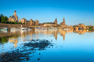 City view with art academy, Frauenkirche (church of our Lady), Hofkirche and Residenzschloss, reflection in the Elbe, morning light, old town, Dresden, Saxony, Germany
