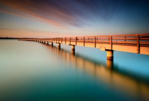 Germany, Saxony-Anhalt, Braunsbedra, Neumark, lake Geiseltalsee, Marina, pier at sunrise