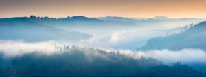Hilly landscape with fog at the Hohenwartsalsperre at sunrise, Obere Saale, Thuringian Slate Mountains Nature Park, Thuringia, Germany