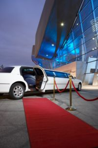 Germany, Munich, stretched limousine at red carpet in front of BMW Welt