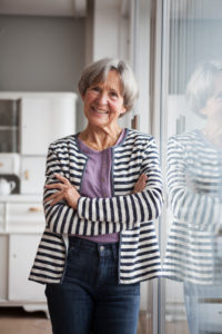Portrait of confident senior woman at home