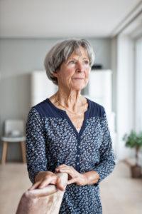 Portrait of pensive senior woman at home