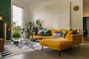 Indoor shot of hygge or scandi style couch in living room, Cologne, Germany