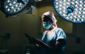 Nurse using a mobile phone in operating room