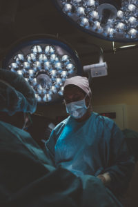 Surgeon and nurse during a surgery