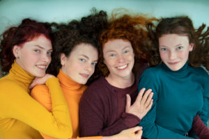 Portrait of happy mother and her three daughters