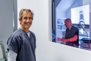Portrait of smiling man in veterinary clinic