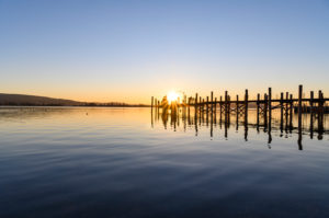 Germany,Baden-Wurttemberg,Constance district,Allensbach,Jetty on Lake Constance at sunset