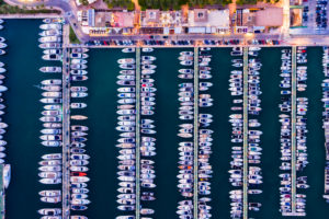 Spain,Balearic Islands,Mallorca,Portals Nous,Puerto Portals,Aerial view of luxury marina at sunset