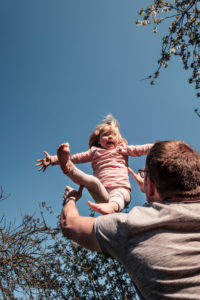 Father throwing little daughter in air
