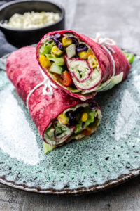 Vegetarian beetroot wraps filled with†tomatoes,red cabbage,corn,iceberg lettuce,cucumbers and cream cheese