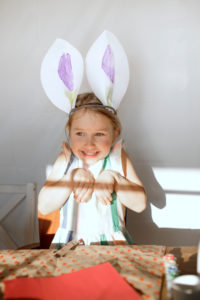 Portrait of little girl with self-made bunny ears