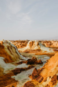 Volcanic landscape against sky at Dallol Geothermal Area in Danakil Depression, Ethiopia, Afar