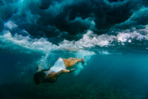 Indonesia, Underwater view of adult woman diving in sea
